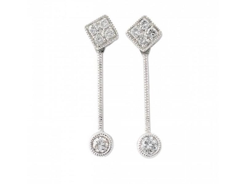 Pendientes largos en oro blanco y diamantes con movimiento