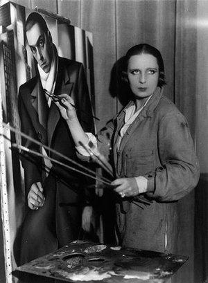 Tamara de Lempicka painting a portrait of her husband, Tadeusz Lempicki, circa 1928, image via Culturepl