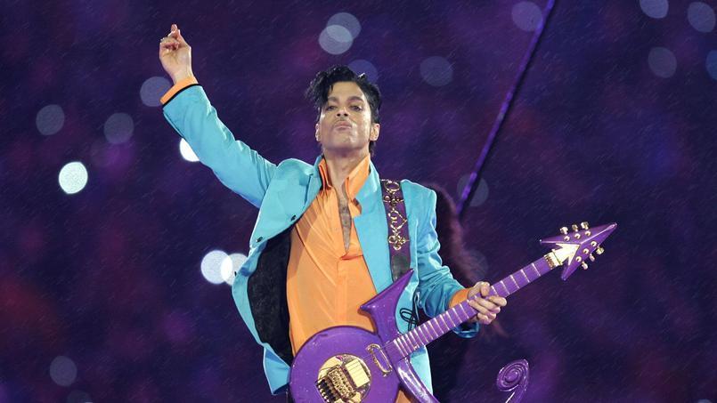 Prince et sa guitare violette, photo ©Chris O'Meara/AP