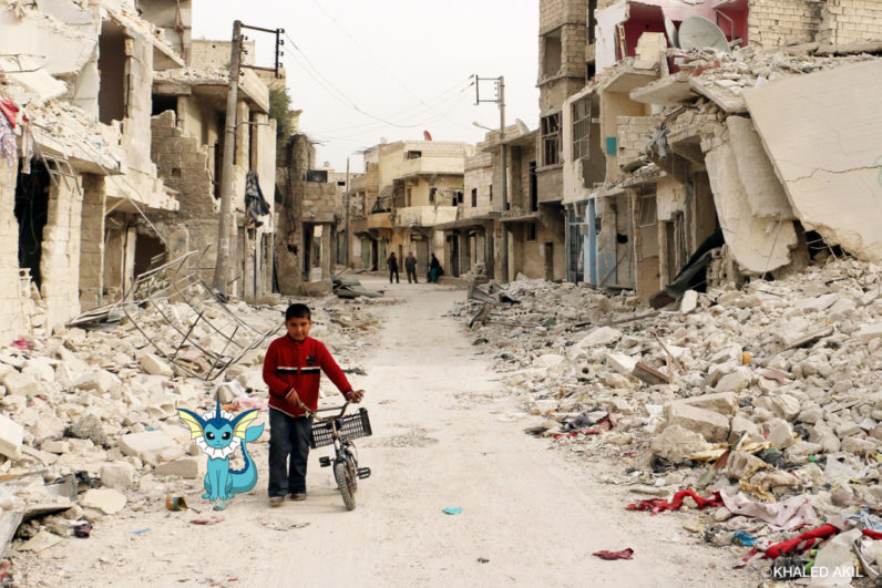 A Syrian boy walks with his bicycle in the devastated Sukari district in the northern city of Aleppo on November 13, 2014, after more than three years of fighting and shelling. Syrians are increasingly unable to escape their country's war as tougher policies in potential host nations are preventing them from taking refuge in the region and beyond. AFP PHOTO / BARAA AL-HALABI (Photo credit should read BARAA AL-HALABI/AFP/Getty Images)