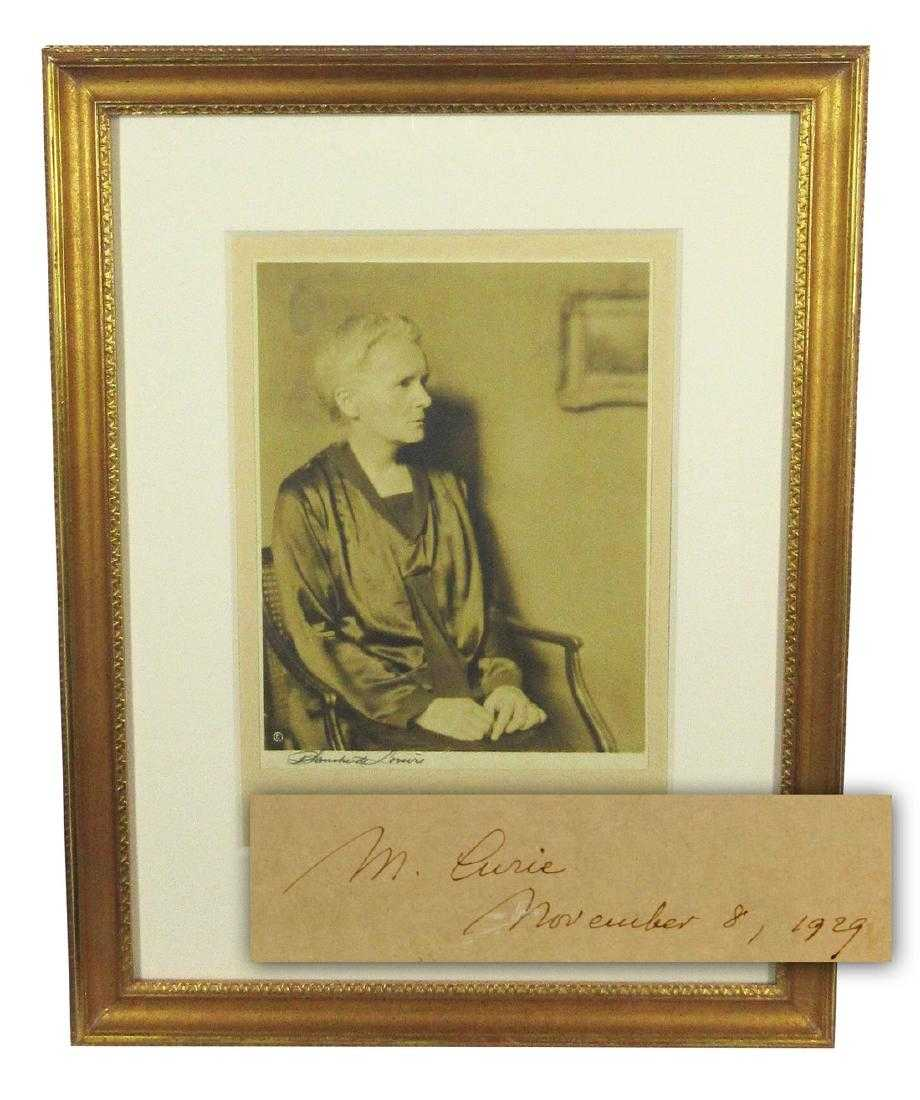 "Rare formal portrait photograph of renowned scientist Marie Curie, shown seated in a chair, signed on the mount as ""M. Curie"" and dated ""November 8, 1929"", framed (est. $6,000-$6,500)."