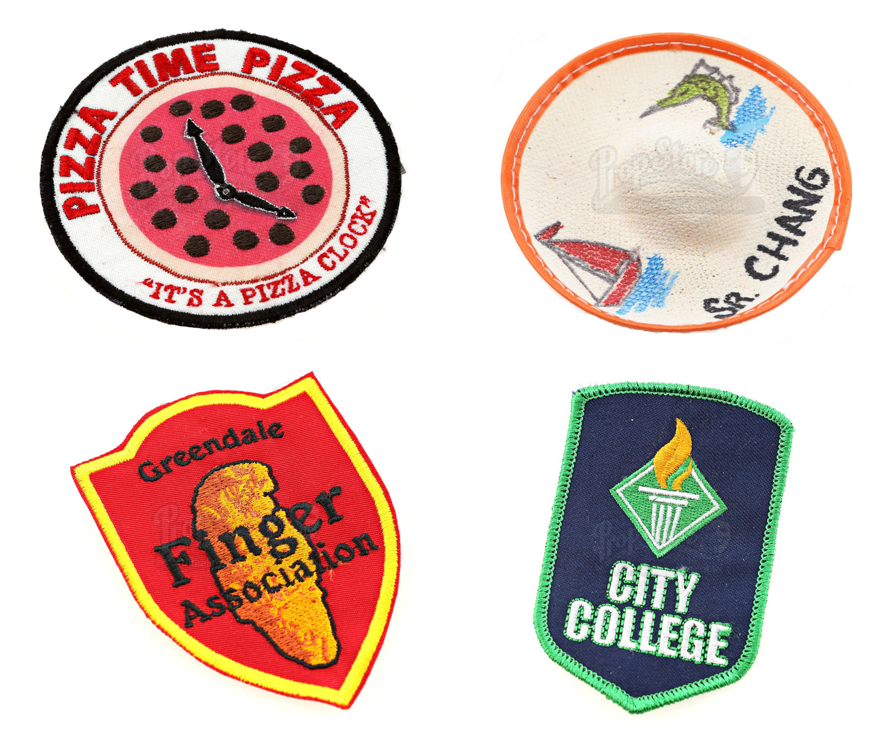 Clockwise from left: Toby's (Robert Tarpinian) Pizza Patch, Britta Perry's (Gillian Jacobs) Mini Sombrero, City College Debate Team Patch, Finger Association Patch
