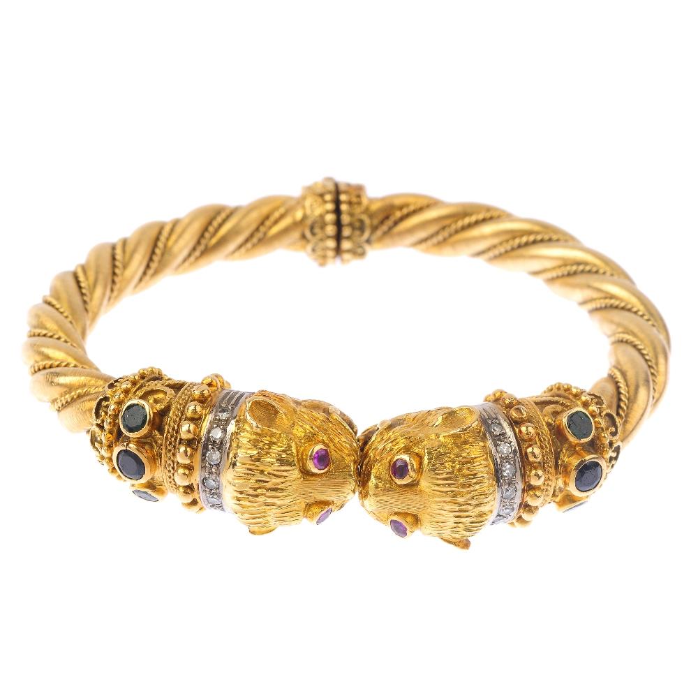 Diamond and gem-set double lion head bangle