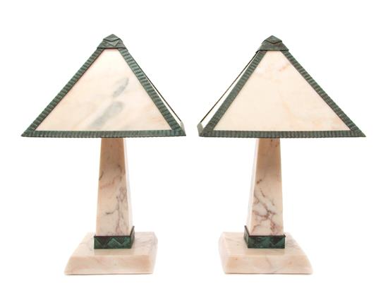 A Pair Art Deco Alabaster and Gilt Bronze Table Lamps, having pyramid form shades raised on obelisk form bases. Height 17 1/2 inches. Estimate $ 1,000-1,500. Leslie Hindman