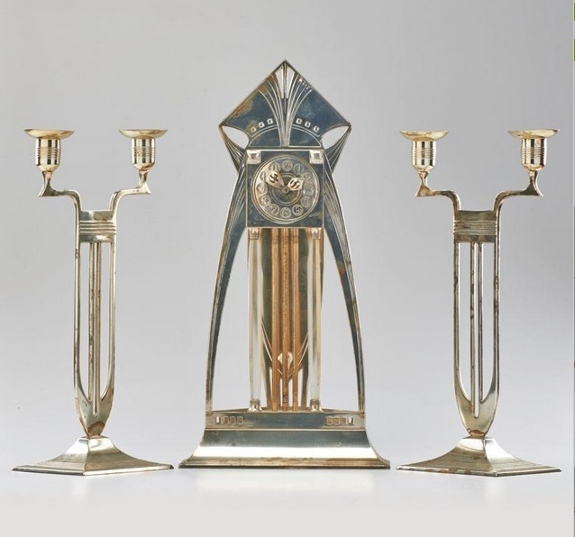 WMF, versilberte  mit elektrischer Hülle und ein Paar zweiarmige Kerzenleuchter. 1930er Jahre, Schätzpreis: 460 EUR. bei Rago