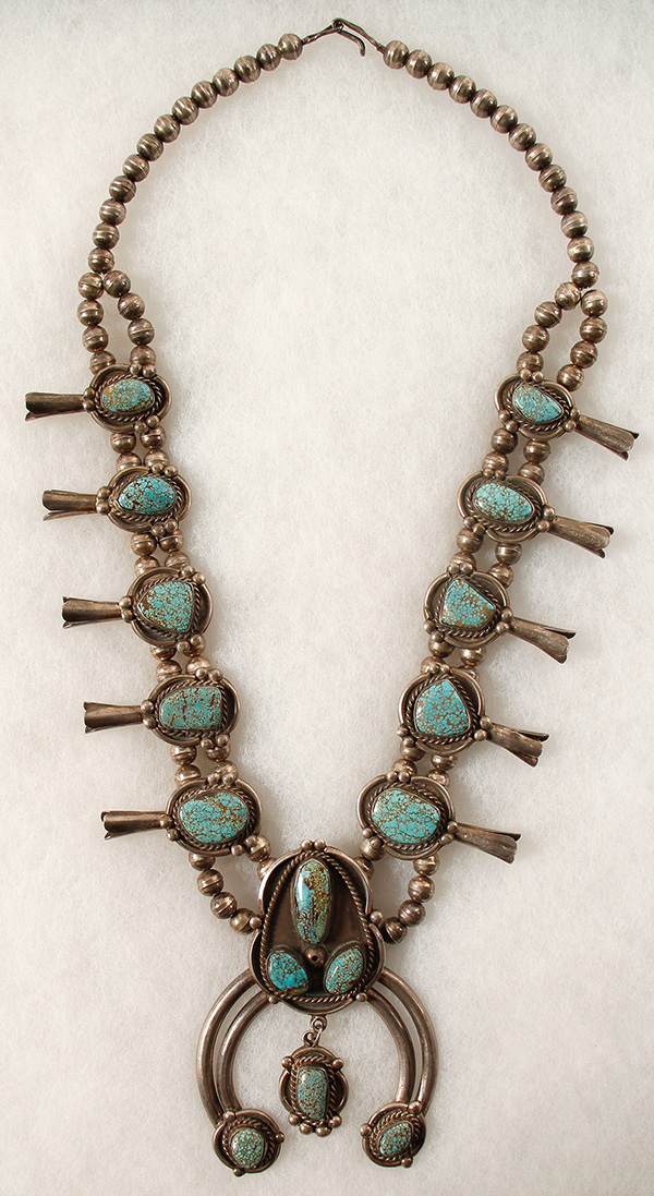 Outstanding vintage Navajo Squash Blossom necklace boasting 16 beautiful turquoise nuggets from the #8 mine in Eureka county, Nevada ($2,500).