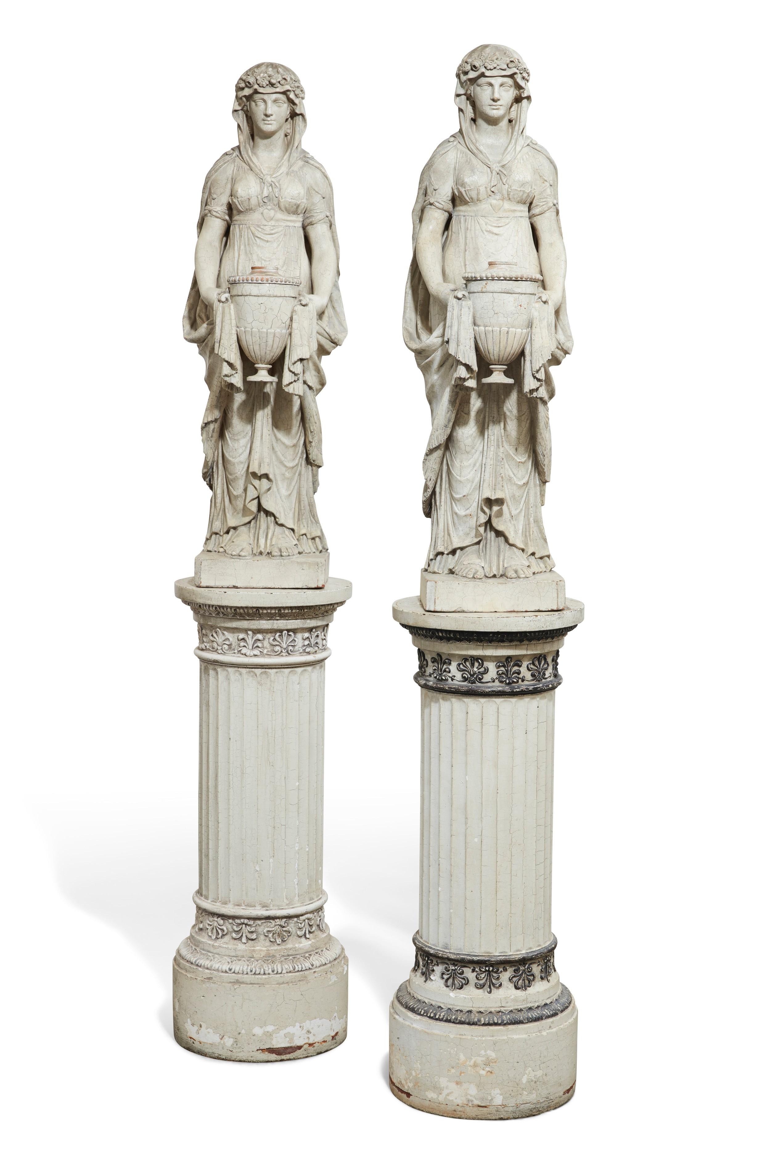 Pair of English Regency 19th century white painted terra cotta figures of vestal virgins, on later pedestals (est. $3,000-5,000).