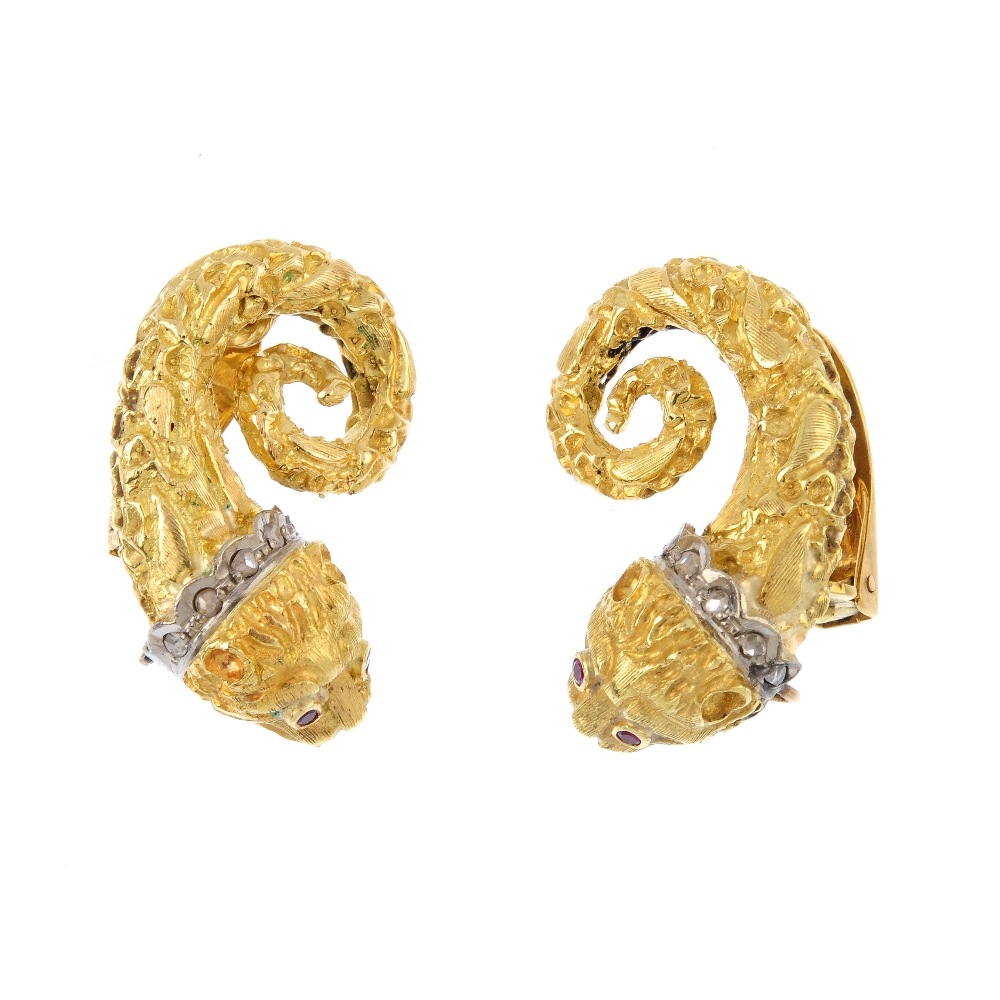 A pair of ruby and diamond lion earring