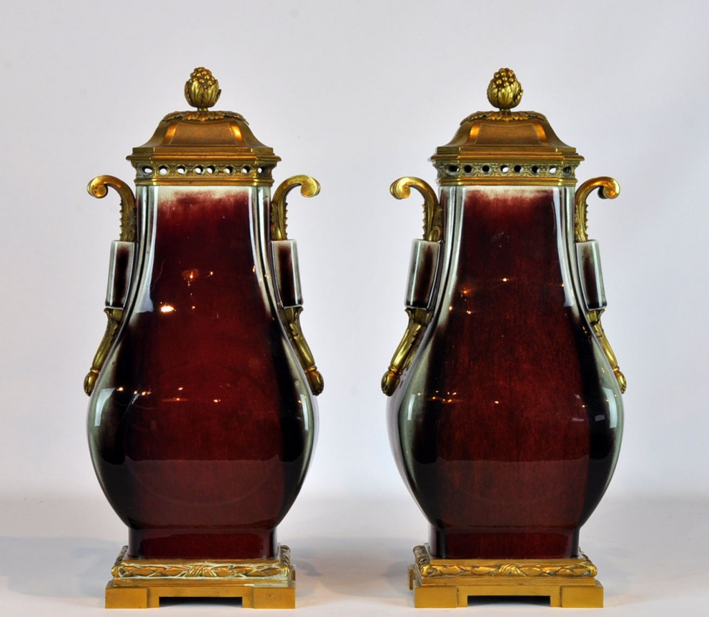 Asian urns on top of French mounts