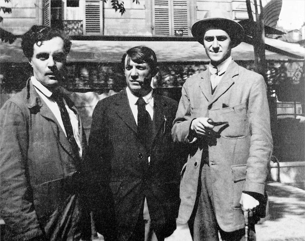 Modigliani, Picasso and André Salmon in front the Café de la Rotonde, Paris Image taken by Jean Cocteau in Montparnasse, Paris in 1916 Image via Modigliani Institut Archives Légales, Paris-Rome