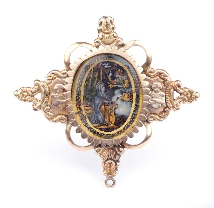The gold brooch with what is believed to be a Flemish painting from the 1800's has an estimate of $870-$1,000.