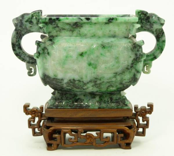 A Chinese Hongshan Culture jade ware piece estimated at $300,000-$400,000