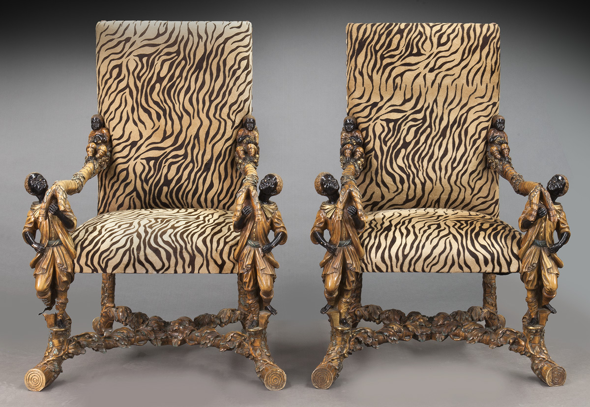 "Large pair of Venetian figural armchairs with carved blackamoor arm supports and tree branch form stretchers. 50.5""H, est. - $6,000 - $8,000"