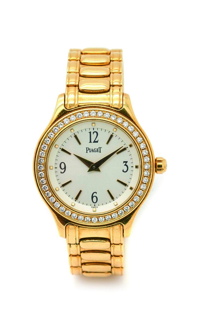 Reloj PIAGET de pulsera para señora en oro y bisel con diamantes talla brillante
