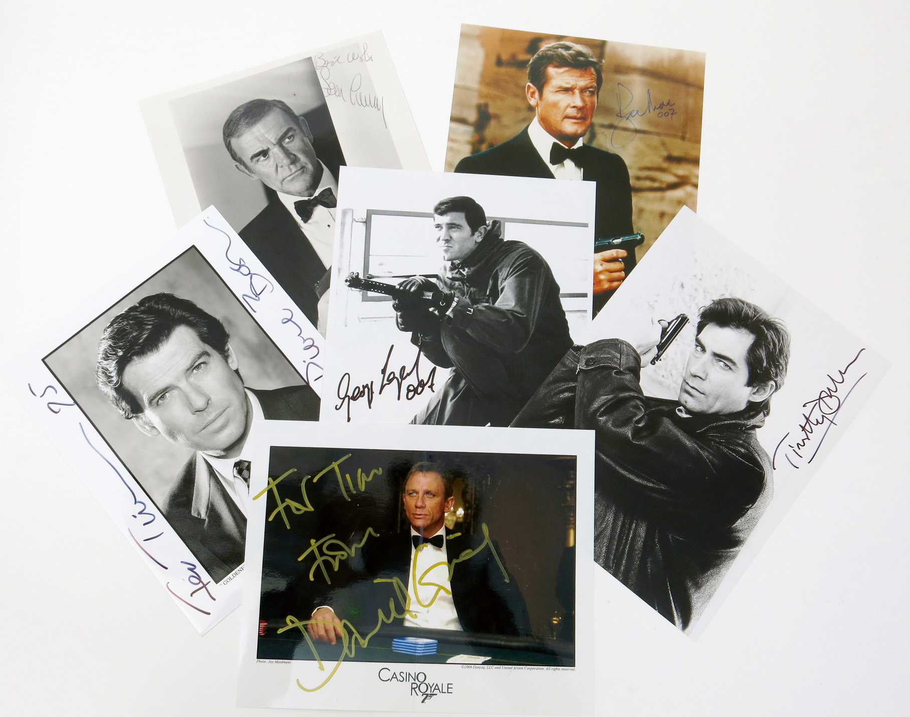 A composite set of all six James Bond promotional photographs signed by the actors, Sean Connery, George Lazenby, Roger Moore, Timothy Dalton, Pierce Brosnan and Daniel Craig, 25.5 x 20.5cm (Sean Connery), (6) Estimate: £500-1000