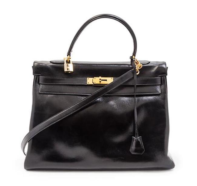 Kelly väska, svart, 35 cm. 1975. Leslie Hindman Auctioneers.