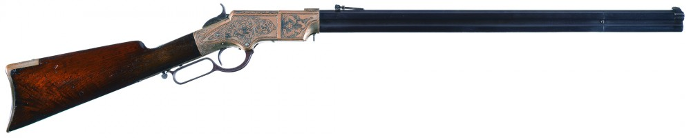 Engraved Henry lever rifle