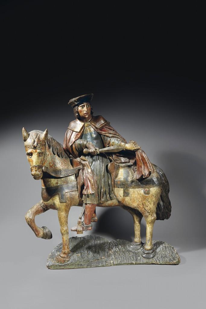 SAINT MARTIN Important groupe équestre en bois sculpté et polychromé représentant Saint Martin assis sur son cheval et coupant son manteau. XVIème siècle