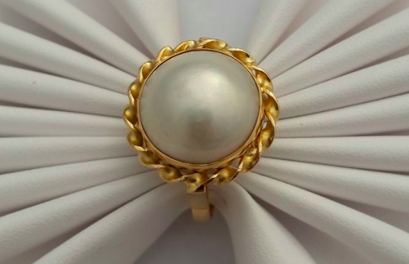 Yellow gold and cultured pearl ringSold for $185