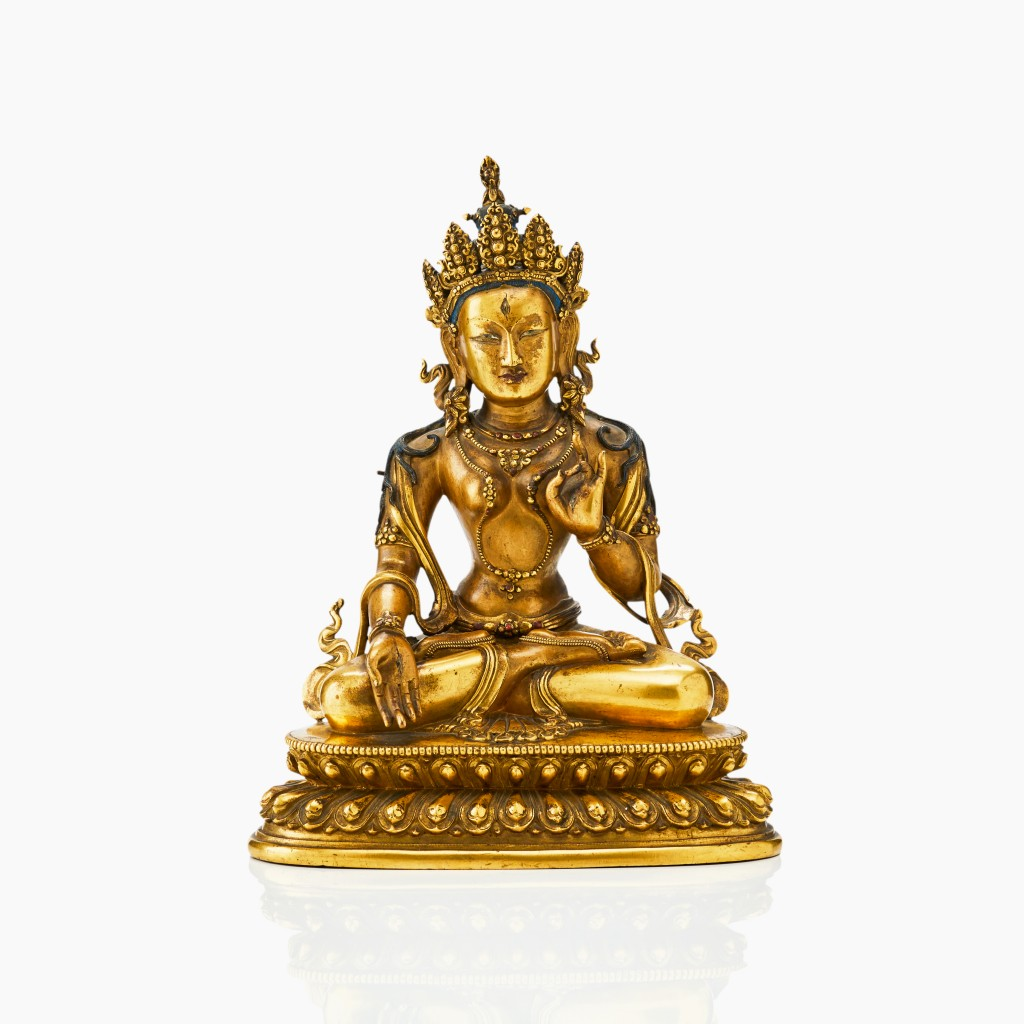 A FINE TIBETO-CHINESE GILT-BRONZE FIGURE OF WHITETARA
