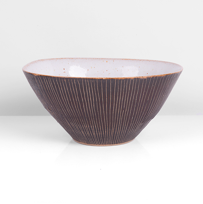 Squared Bowl, circa 1958 Stoneware, manganese glaze with fine sgraffito to the exterior, the interior with shiny white glaze with a delicate oatmeal speckle, impressed LR and HC seals H 6.4cm, W 14.0cm, D 12.1cm PROVENANCE: Private Collection, Essex