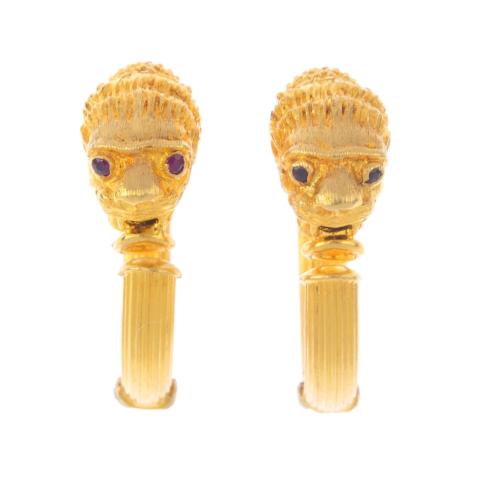 Pair of 'Animal Head' earrings in the shape of lions' heads, with ruby eye highlights