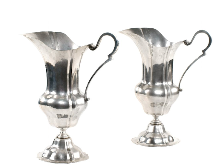 A pair of heavy silver pitchers