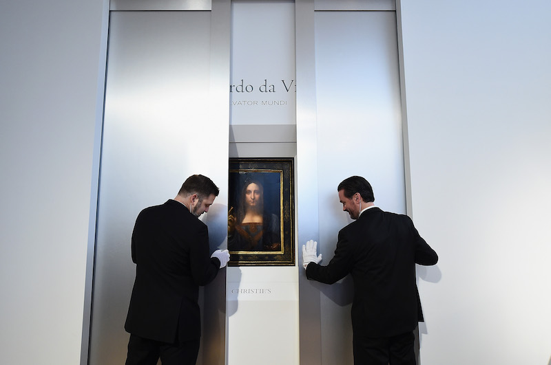 NEW YORK, NY - OCTOBER 10: Christie's unveils Leonardo da Vinci's 'Salvator Mundi' (pictured) with Andy Warhol's 'Sixty Last Suppers' at Christie's New York on October 10, 2017 in New York City. (Photo by Ilya S. Savenok/Getty Images for Christie's Auction House)
