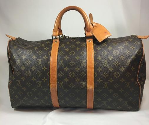 Louis Vuitton Keepall 50 Travelbag in monogram canvas. Still In Fashion