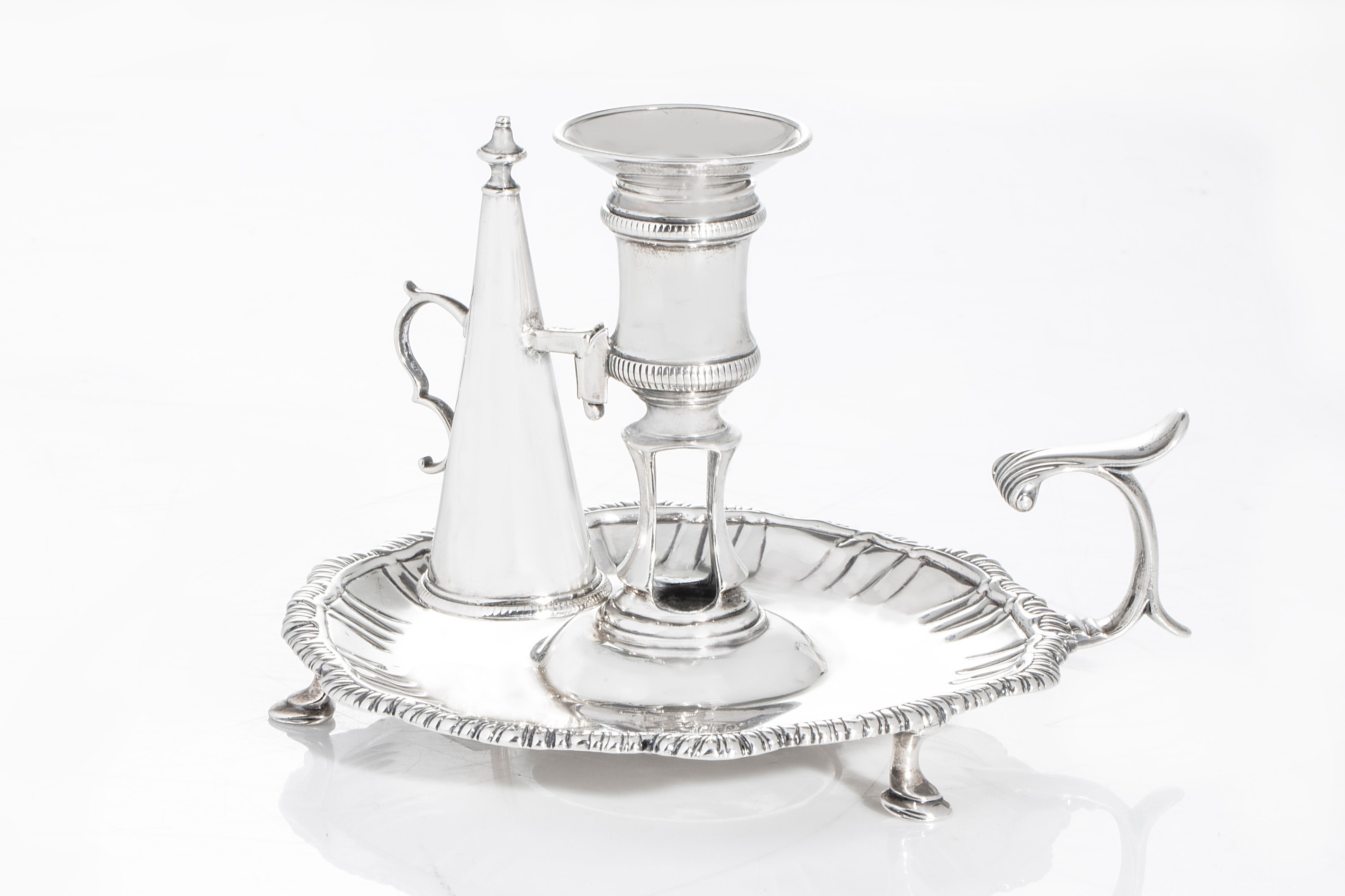George III sterling silver chamberstick by William Cafe (London, 1762) (est. $300-$500).