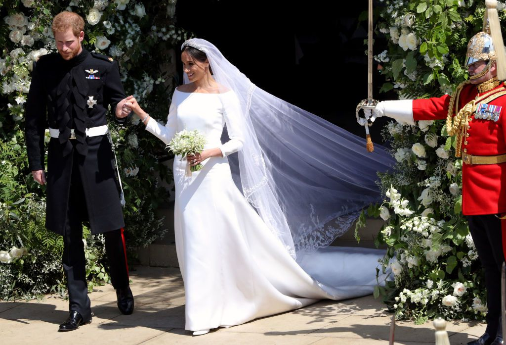 Meghan Markle wearing a Givenchy dress designed by Clare Waight Keller at the royla wedding to Prince Harry, May 2018. Image via Town & Country