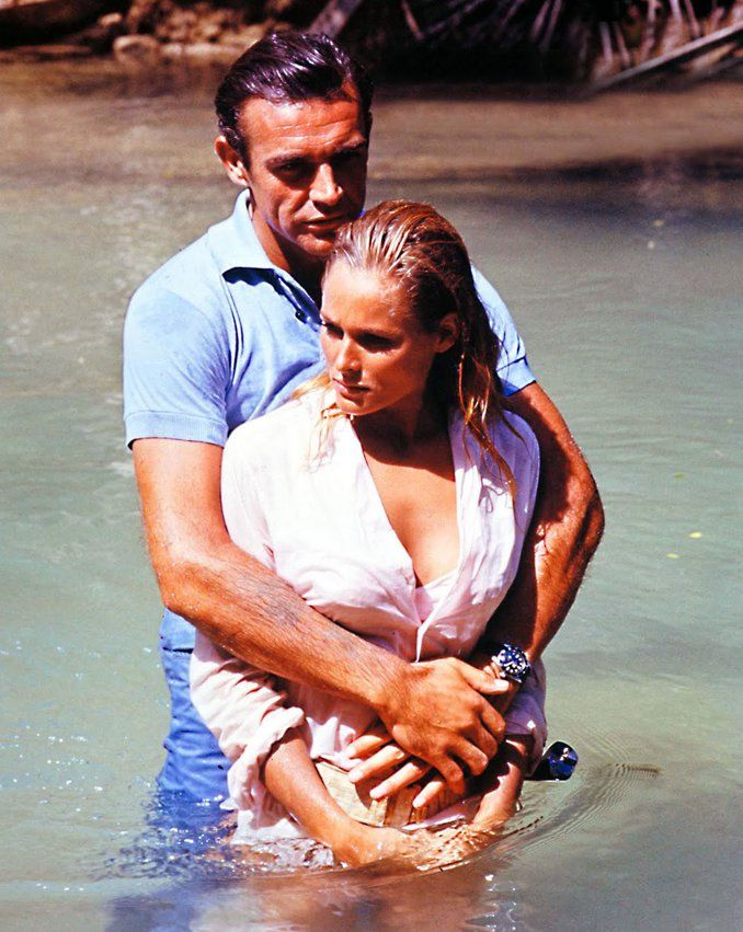 Sean Connery as Bond and Ursula Andress as Honey Rider in Dr. No, 1962