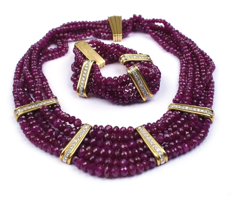 Bracelet and necklace (known as a Parure) in gold, diamonds and rubies have an estimate of $10,000-$16,300.