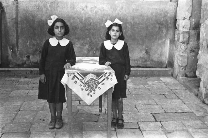 Students of Aisha Om el Mo'minin School for Girls. Sakakini (right) and Hadiyeh Bsat. School courtyard, Saida, Lebanon, 1948-49. Hashem el Madani 2007 by Akram Zaatari born 1966