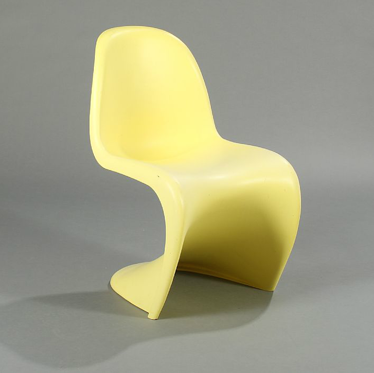 "Verner Panton: ""Panton chair"". A yellow plastic side chair with matt surface. Designed 1958. Manufactured and stamped by Vitra. Utrop: 1.900 Sek Bruun Rasmussen"