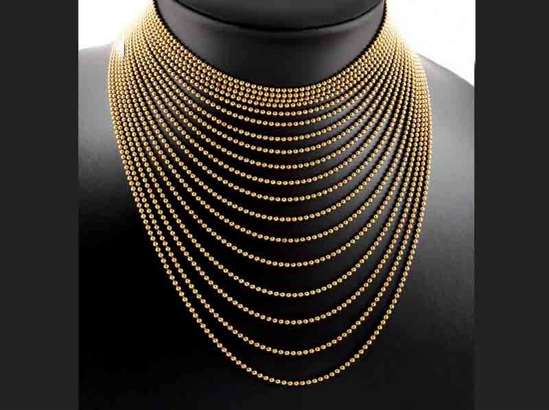 """Gargantilla Cartier """"Draperie"""". Formada por dieciocho hilos de cuentas esféricas realizadas en oro dispuestas en cascada. Precio de salida: 4.750 EUR"""