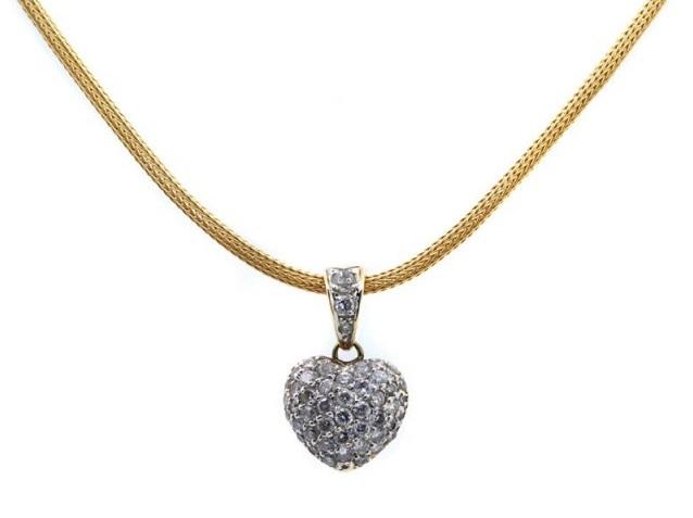 Colgante diseño corazón en oro bicolor con brillantes