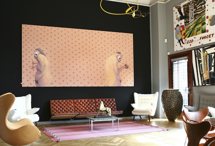 """An interior image from Bruun Rasmussen's showroom at Bredgade in Copenhagen with Poul Kjaerholm's sofa """"PK-26"""" and a pair of sheepskin-dressed """"Papa Bear"""" by the Danish master Hans J Werner"""