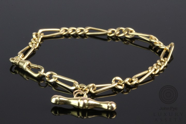 A 9ct Gold FIgaro-link Bracelet with T-bar Pendant. Photo: John Pye Auctions