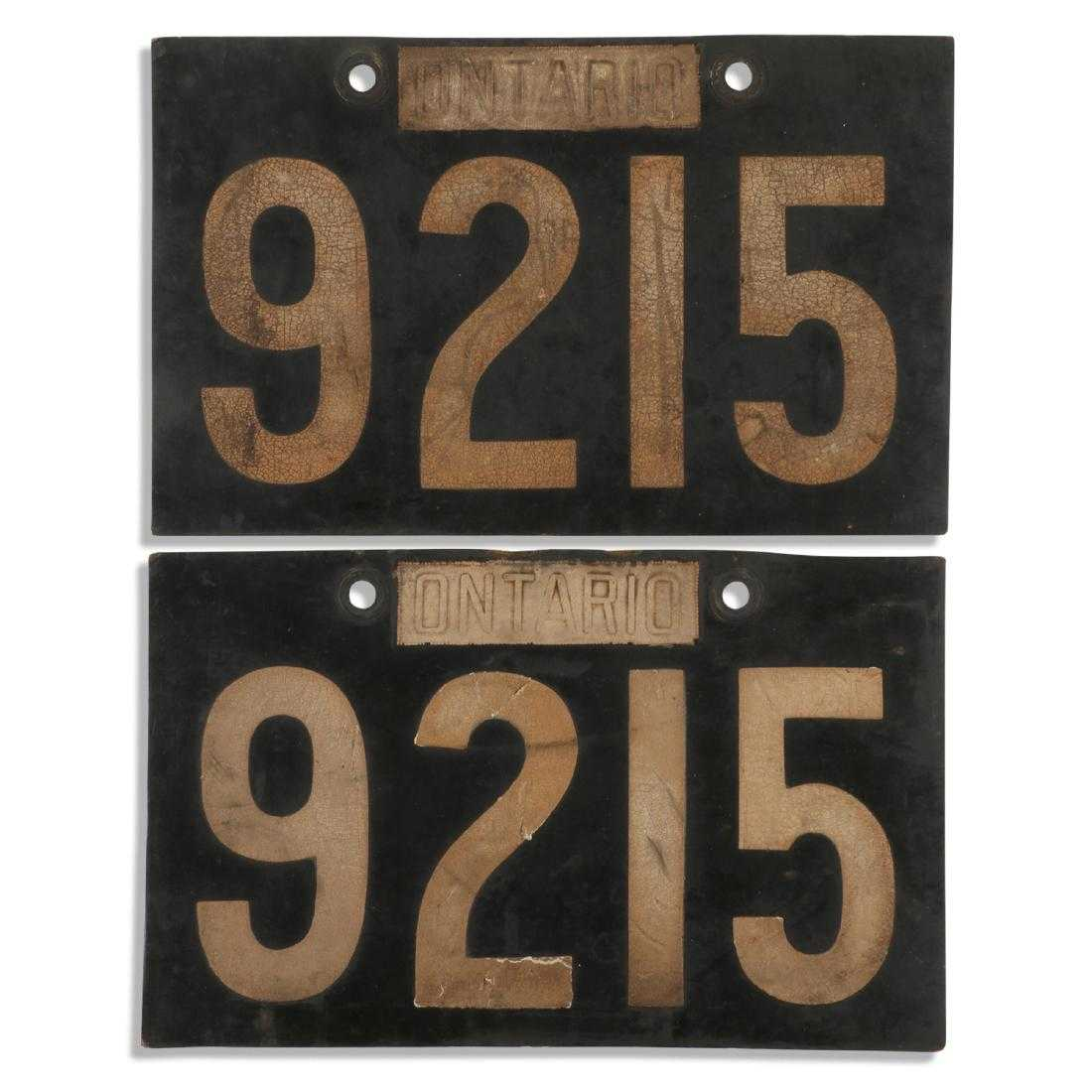 "Pair of 1910 rubber Ontario plates, with serial number ""9215"", each one 11 ¾ inches by 7 ¼ inches, with no cracks (est. CA$3,000-$5,000)."