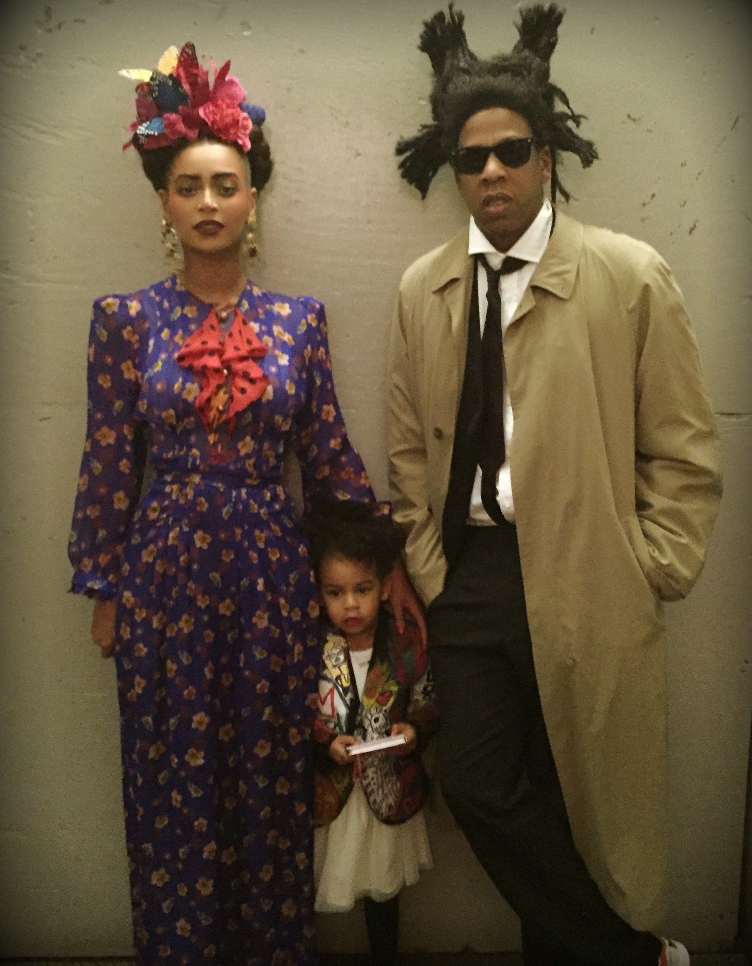 Beyonce dressed as Frida Kahlo and Jay Z dressed as Jean-Michel Basquiat with their daughter Blue Ivy at a Halloween party in 2014 Image via Bossip