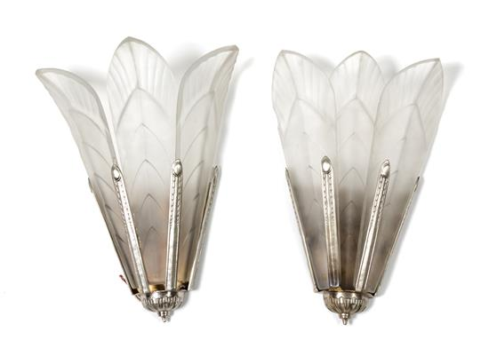 A Pair of Italian Art Deco. Frosted Crystal and Silvered Metal Wall Sconces, each of stylized floral form, labeled Sabino. Height 19 inches. Estimate $ 500-700. Leslie Hindmann.