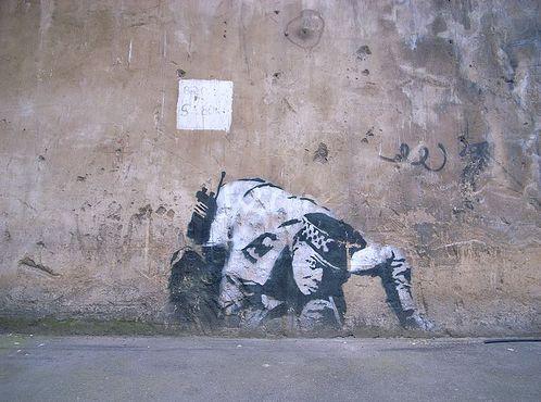 Banksy's Snorting Copper Image via Banksyunmasked