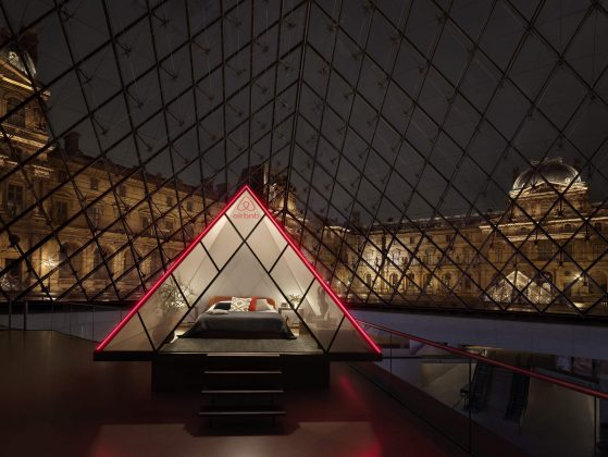 The bedroom under the iconic Louvre pyramid. Image: Julian Abrams for Airbnb