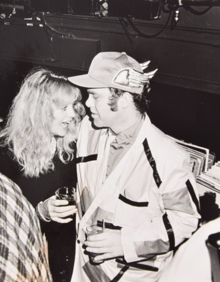Large scale photograph of Elton John ( singer-songwriter/musician/composer) and Goldie Hawn (actress/director/producer) at Studio 54.