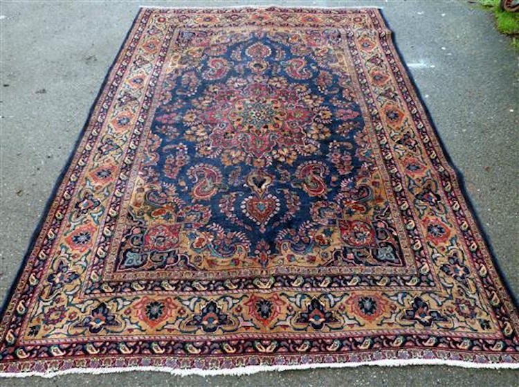 Tabriz blue ground carpet with central shaped cartouche and floral motifs throughout. Estimate $315 - $ 390. Photo via Ewbank's