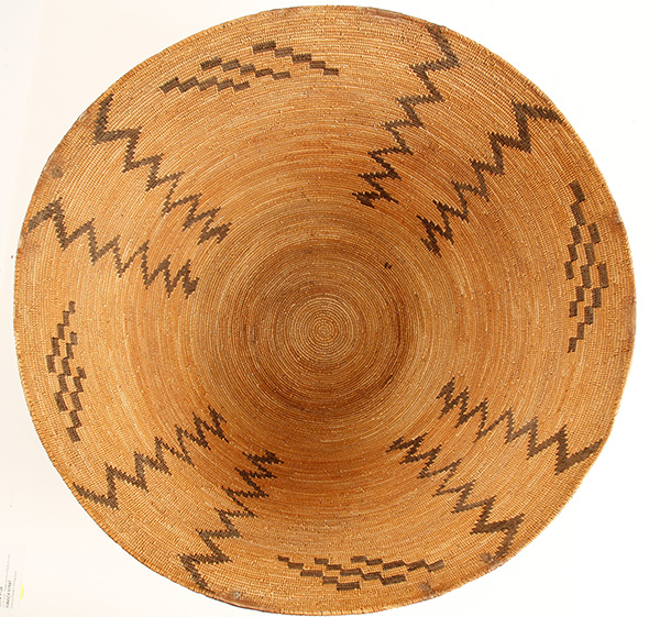 Large, circa 1900-1910 Mono basket, 19 ½ inches tall, intended for utility or cooking but never used and probably made for sale to the Anglo market, displaying zig-zag patterns ($2,625).