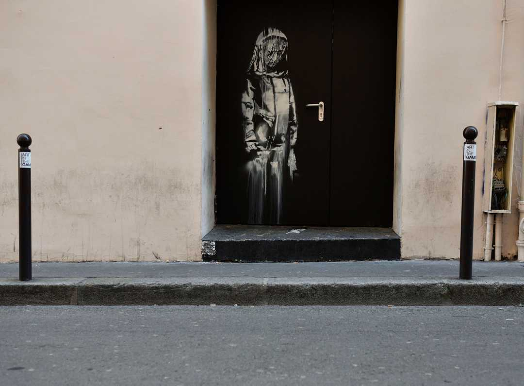 Banksy work on one of Le Bataclan's emergency exits stolen the night of Saturday. Photo via USAToday.