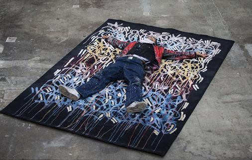 """JonOne lying on """"Rainbow"""" 300 x 200 cm"""