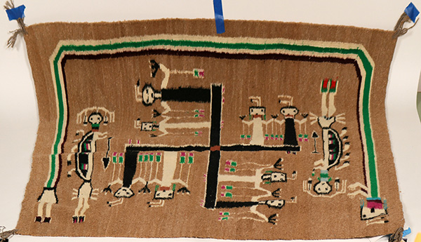 Hand-woven Navajo rug with a tribal design, 39 ½ inches by 44 inches, made by America's Natives from the Russell Foutz Indian Room in Farmington, New Mexico ($2,875).